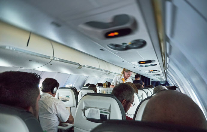 GERMANY - JUN 7 2015: Lufthansa Airlines plane full with passengers with smiling stewardess serving travelers - Bigstock: 153561836
